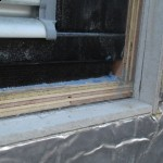 Bottom corner of the window outside showing the masterboard to the edge of the insulation and the ply set back.